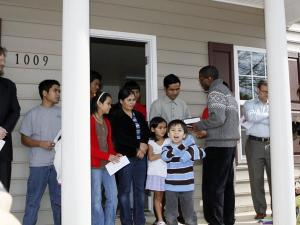 Members of Christian, Jewish, and Muslim communities joined Habitat of Durham on Sunday, Feb. 21, 2010, to dedicate the Rahlan-Siu family's new home at 1009 Carroll St. in Durham.