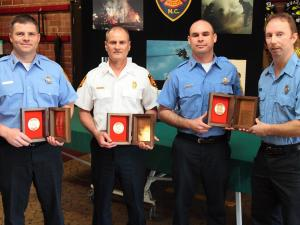 Senior Firefighter Daniel Fox, Capt. Gary Amato, Senior Firefighter John Mitchell and Lt. Donnie Wall (left to right), all with the Raleigh Fire Department, received the Firemark Award for Heroism during a ceremony at Fire Station 16 Saturday, March 27, 2010. They were honored for saving the lives of two women during a townhouse fire in May 31, 2008. (Photo courtesy of the City of Raleigh)