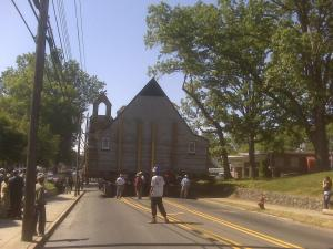 Holy Cross Catholic Church rolls down the street in Durham.