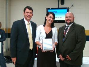 First-year teacher Erin Gamble (center) shows her award.