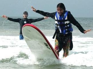 Wilmington surfing teachers Jack Viorel and Kevin Murphy held a four-day surfing camp for 23 girls and two nuns from the Home of Hope orphanage in Kochi, India. (Photo courtesy of Paul Wilkes)