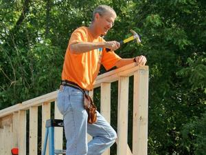 Chuck Swoboda, CEO of Cree, helps build a home with all-LED lighting at 1015 Moreland Ave. in Durham. (Photo courtesy of Camden Watts and Erik Shepard)