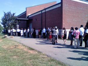 A line of job seekers wrap around the Mebane Art & Community Center on Thursday for a Tanger Outlets job fair.