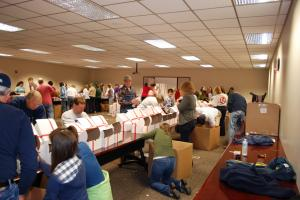 "About 180 volunteers spent Saturday, Nov. 7, 2010, packing 5,000 gift boxes to be shipped to North Carolina-based service members deployed overseas as part of the North Carolina State Employees Credit Union's ""Supports Our Troops"" campaign. (Photo courtesy of NCSECU)"