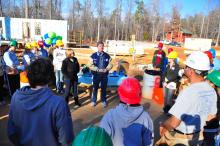 """Martin Luther King Jr. Day weekend marked the start of """"UNC Build-a-Block,"""" an effort to build 10 Habitat for Humanity houses for university and UNC Hospitals employees. More than 200 UNC students, faculty and staff, including Chancellor Holden Thorpe, kicked off the construction phase in the Phoenix Place neighborhood, on Rogers Road, on Friday, Jan. 14, 2011. (Photo courtesy of UNC)"""