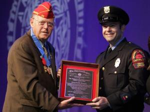 National Commander Jimmie Foster presents the American Legion Law Officer of the Year Award to Raleigh police officer Scott Womack on Aug. 31, 2011, during the organization's annual convention in Minneapolis.