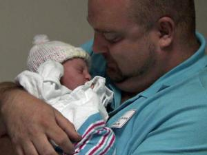 Brian Walker holds his daughter, Ashley Lynn, who was born at 1:37 p.m. at Rex Hospital in Raleigh on Father's Day 2012.