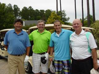 WRAL Chief Meteorologist Greg Fishel, country music artist Jason Michael Carroll and other golfers pose at Prestonwood Country Club in Cary for the Stand By Me Tournament.