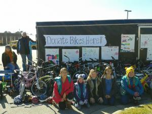 Girl Scout Troop 1332 out of Fayetteville collected bikes Saturday for The Bicycle Man Community Outreach Project.