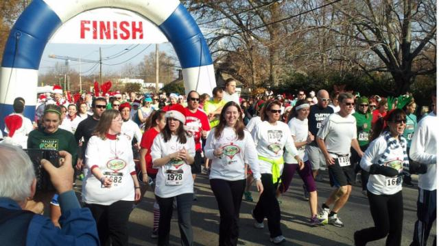Runners and walkers decked out in holiday apparel for the Jingle Bell Run