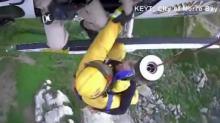 IMAGE: Rescue crews ruin man's rock-top proposal plan