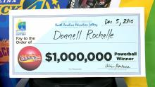 IMAGE: Raleigh man cashes $1 million Powerball check