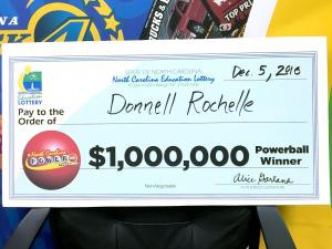 Donnell Rochelle, of Raleigh, was feeling good Monday when he collected the big check that symbolized his $1 million-winning Powerball play.