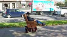 IMAGE: How he rolls: Combo recliner, wheelchair gets man going