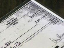 An enlarged copy of a $500,000 check from lobbyist Don Beason to Jim Black.