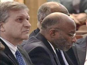 Rep. Thomas Wright is flanked by attorneys Douglas Harris (left) and Irving Joyner (obscured) during a March 20, 2008, legislative session where he was expelled from the House.