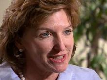 Hagan demands Dole take down ad on faith