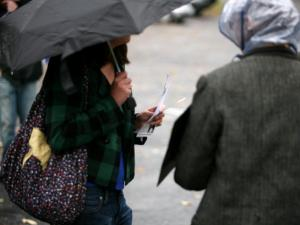 Students wait in the rain to vote in Raleigh Nov. 3.