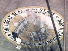 North Carolina state seal in front of Legislative Building
