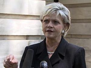 Gov. Bev Perdue says it will cost $5 million every day the state runs under a stopgap measure while lawmakers debate a spending plan.