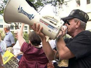 Hundreds of protesters lined St. Mary's Street on Aug. 7, 2009 outside the Raleigh office of 13th District Congressman Brad Miller to express opposition to the health care reform proposal working its way through Congress.
