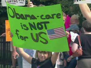 Opponents of a proposal to overhaul the nation's health care system protest outside of U.S. Sen. Kay Hagan's office in Raleigh on Aug. 14, 2009.