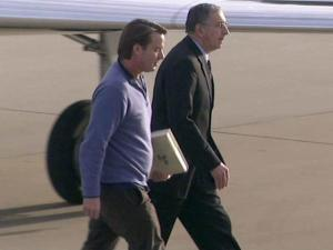 John Edwards, left, exits a private jet at Raleigh-Durham International Airport on Dec. 11,2009, after a visit to the Virginia farm of a major political donor.