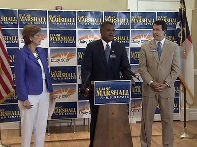 Democratic U.S. Senate candidate Elaine Marshall is joined by former foes Ken Lewis, center, and Cal Cunningham during a June 23, 2010, rally to unite the party for the fall campaign.
