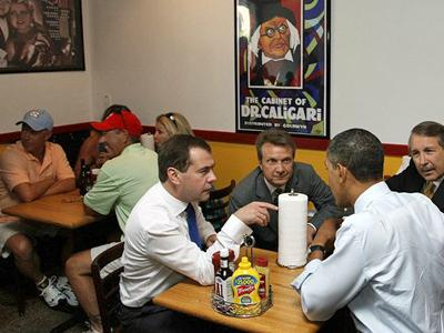 Helen and Ricky Wadford and Dawn and Jake Phillips sit at a table behind President Obama. (Photo from the President of Russia's website)