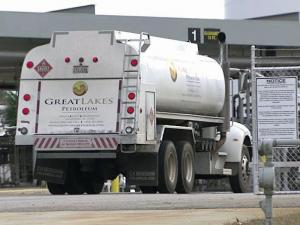 Trucks fuel up at Motiva Enterprises to deliver gasoline to area gas stations.