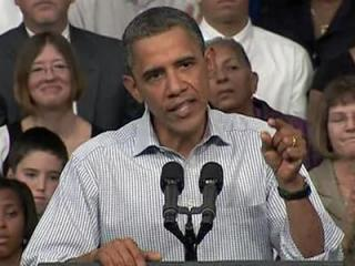 President Barack Obama speaks to a crowd on the campus of Guilford Technical Community College, one of several stops on a three-day tour across North Carolina and South Carolina to promote his jobs bill.