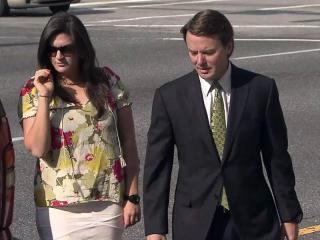 John Edwards walks into the federal courthouse in Greensboro with his daughter Cate on May 2, 2012, during his criminal trial.