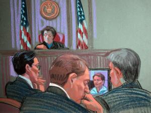 Federal prosecutors watch a video of a 2008 television interview of John Edwards as the government finished its campaign finance fraud case against Edwards on May 10, 2012. (Sketch by Christine Cornell)