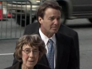John Edwards walks into the Greensboro federal courthouse on May 18, 2012, with his mother, Bobbie Edwards, while awaiting a jury verdict on charges that he broke campaign finance rules.