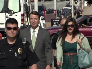 Police officers escort John Edwards and his daughter Cate to the federal courthouse in Greensboro on May 22, 2012, as Edwards awaits a jury verdict on campaign finance charges.
