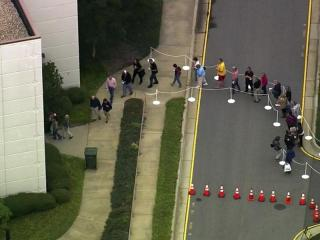 Voters waited in long lines in some locations on the first day of early voting in 2012.