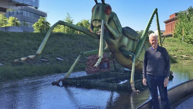Posing with a statue of a giant grasshopper on Sunday, former Pres. Bill Clinton tweeted that his presidential library, the Clinton Presidential Center in Little Rock, Arkansas, had been bugged.