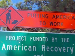 The state DOT has erected 54 signs statewide to note that federal stimulus money is paying for road projects. The $135,000 cost comes from discretionary money the state receives from federal transportation officials.