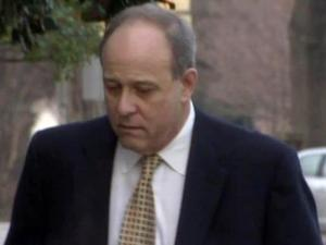 Lee Fitzgerald Cowper walks into the federal courthouse in Raleigh on Feb. 7, 2011, to plead guilty to fraud in a scheme involving using public funds to pay for construction of a garage for the former New Hanover ABC administrator.
