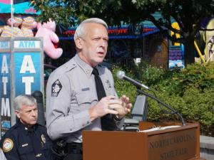 Wake County Sheriff Donnie Harrison speaks to the media at the State Fair on Oct. 16, 2014.