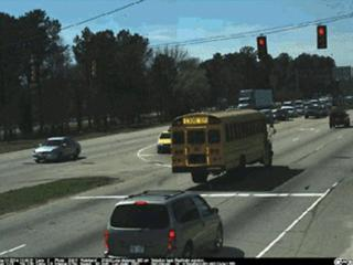 A Wake County school bus runs a red light in Raleigh. (Photo courtesy of the City of Raleigh)