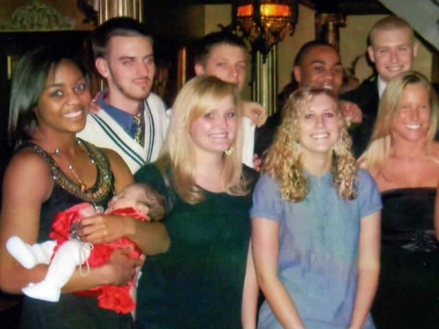 Christian Griggs (center) poses with his friends after his wedding ceremony in January 2009. Krystle Griggs, his younger sister, is pictured on the left holding his infant daughter Jaden (Courtesy Brad Buske).