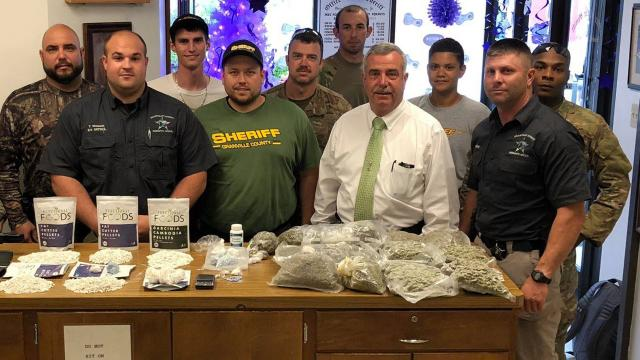 Granville Sheriff Brindell Wilkins with drug officers