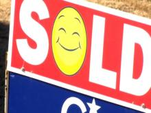 house sale, sold sign