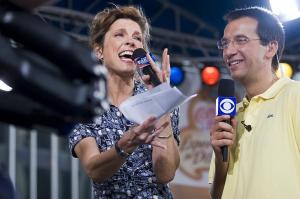 CBS Early Show anchor Hannah Storm, left, and weather anchor Dave Price smile as they broadcast the Early Show live Friday morning.