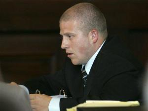 Durham Police Investigator Benjamin Himan testifies during Durham County District Attorney Mike Nifong's North Carolina state bar trial in Raleigh, N.C., Tuesday, June 12, 2007. Nifong faces several ethics charges tied to his handling of the Duke lacrosse rape case. (AP Photo/Gerry Broome, Pool)