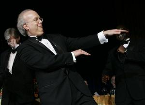 White House Deputy Chief of Staff Karl Rove performs with comedians Colin Mochrie and Brad Sherwood, not in picture, at the Radio and Television Correspondents  Association annual dinner, in this March 28, 2007, fille photo, in Washington. Dancing at the back are White House correspondents.   (AP Photo/Manuel Balce Ceneta/FILE)