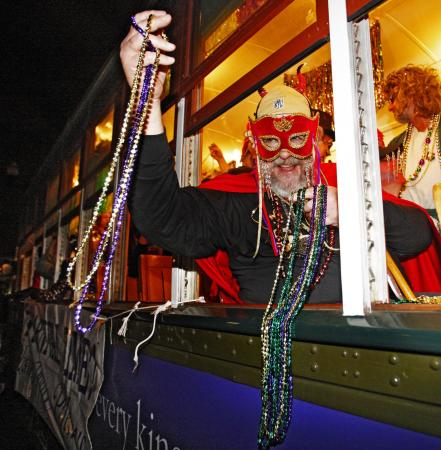 The Krewe of Phunny Phorty Phellows travels on the New Orleans street car tossing beads to onlookers in New Orleans, Sunday, Jan. 6, 2008, which is also known as Twelfth Night and is the official start of Carnival Season. Mardi Gras day is Feb. 5, 2008. (AP Photo/Judi Bottoni)