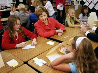 First lady Laura Bush observes a reading lesson in a fourth grade class at Rolling Ridge Elementary School in Olathe, Kan. Tuesday, March 25, 2008. (AP Photo/Charlie Riedel)