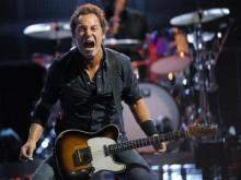 Bruce Springsteen performs in a concert Sunday night, July 27, 2008, at Giants Stadium in East Rutherford, N.J.  (AP Photo/Bill Kostroun)
